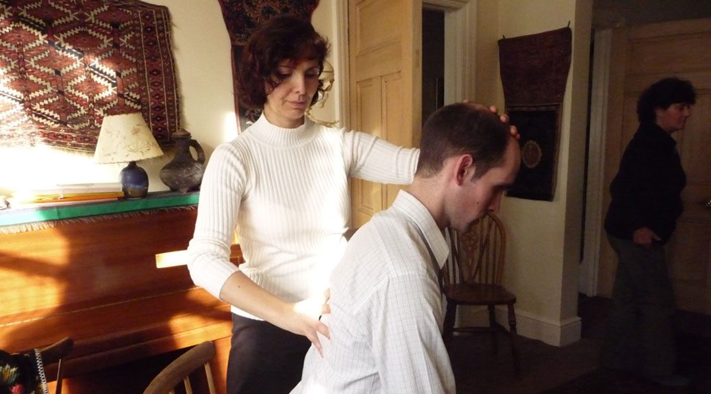 Photograph of students working with the Alexander Technique at the Centre for the Alexander Technique